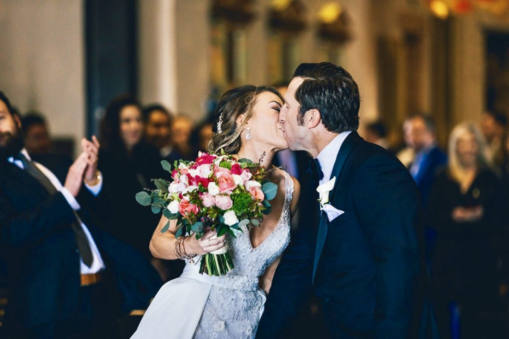 Bride and Groom Kissing after Ceremony in Catholic Church