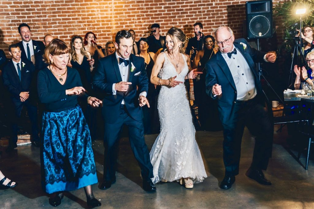 Bride and groom dancing at Herb & Wood in San Diego